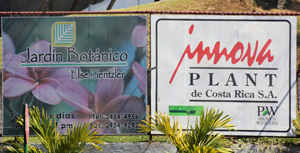 Signs at the entrance to the botanical garden and ornamental plant export company.