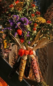 Combine ornamental corn with dried flowers and other items for natural seasonal decorations.