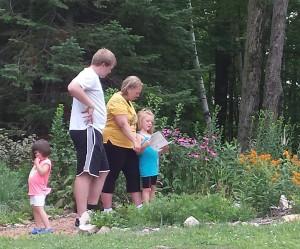 family touring a garden