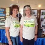 Volunteers posing by educational display