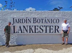 Gustavo and Dan flank the entrance sign to the Lankester Botanical Garden.