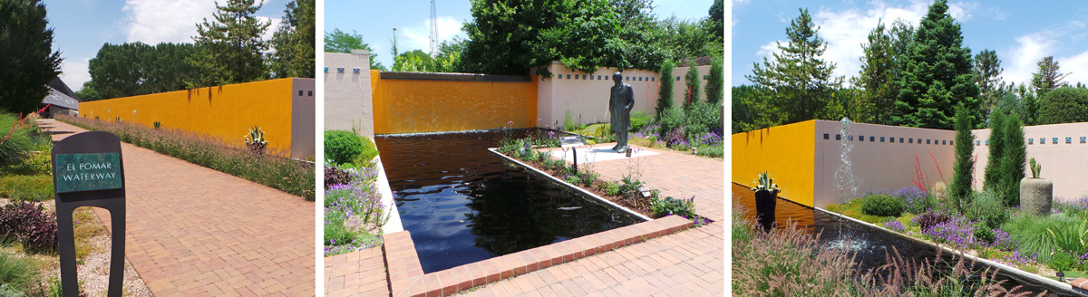 The El Pomar Waterway has a long brick pathway and reflecting pool, with grasses and other plants.