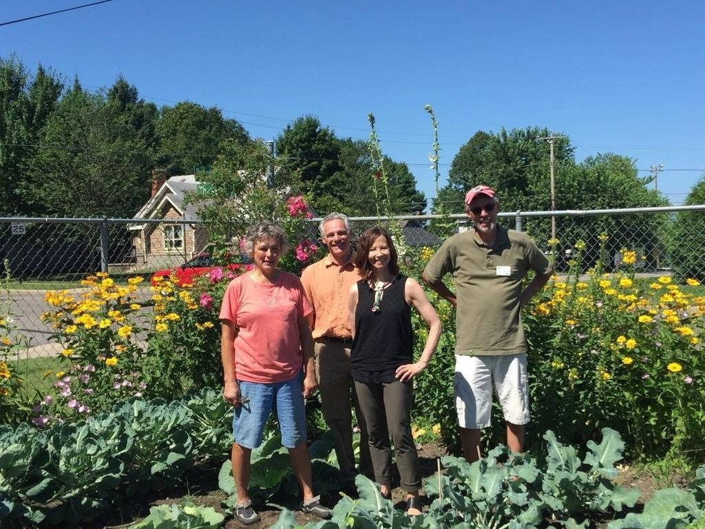 Oneida County UW-Extension Master Gardener Volunteers in the garden with Chancellor Sandeen and Provost and Vice Chancellor Brower.