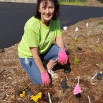 A Master Gardener Volunteer plants native flowers at the new Northern Wisconsin State Fairgrounds Native Planting and Butterfly Waystation.