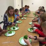 Wakanda Elementary School 3rd graders enjoying produce from their school garden, grown with the help of Master Gardener Volunteers.
