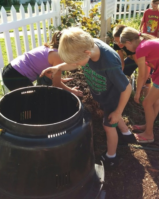 Master Gardener Volunteers facilitate youth garden program at North River Front Park.
