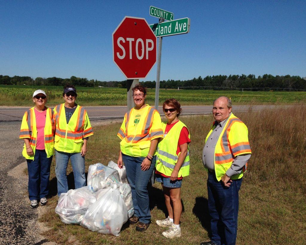 Master Gardener Volunteers pick up roadside debris .