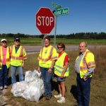 Master Gardener Volunteers pick up roadside debris .