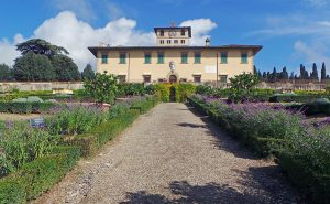 A wide gravel path leads up to Villa della Petraia.