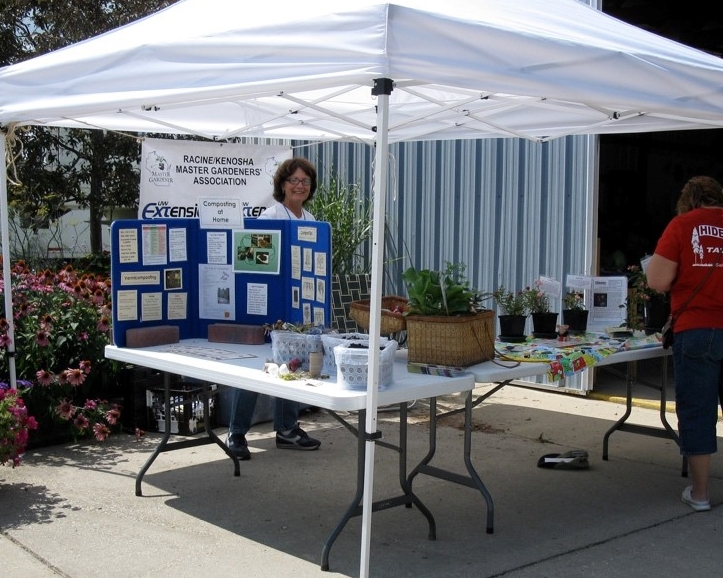 volunteer staffing an educational booth