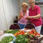 two ladies enjoying vegetables
