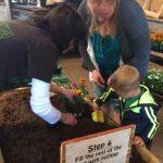 volunteer helping family garden