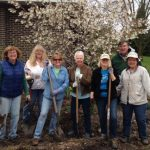volunteers posing in garden