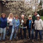 volunteers posing in garden
