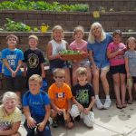image of kids posing with plants