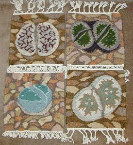 Weavings with lithops designs, by Karakulia Weavery, Swakopmund, Namibia.