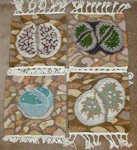 Weavings with lithops designs, by Karakulia Weavery, Swakopmund, Namibia.