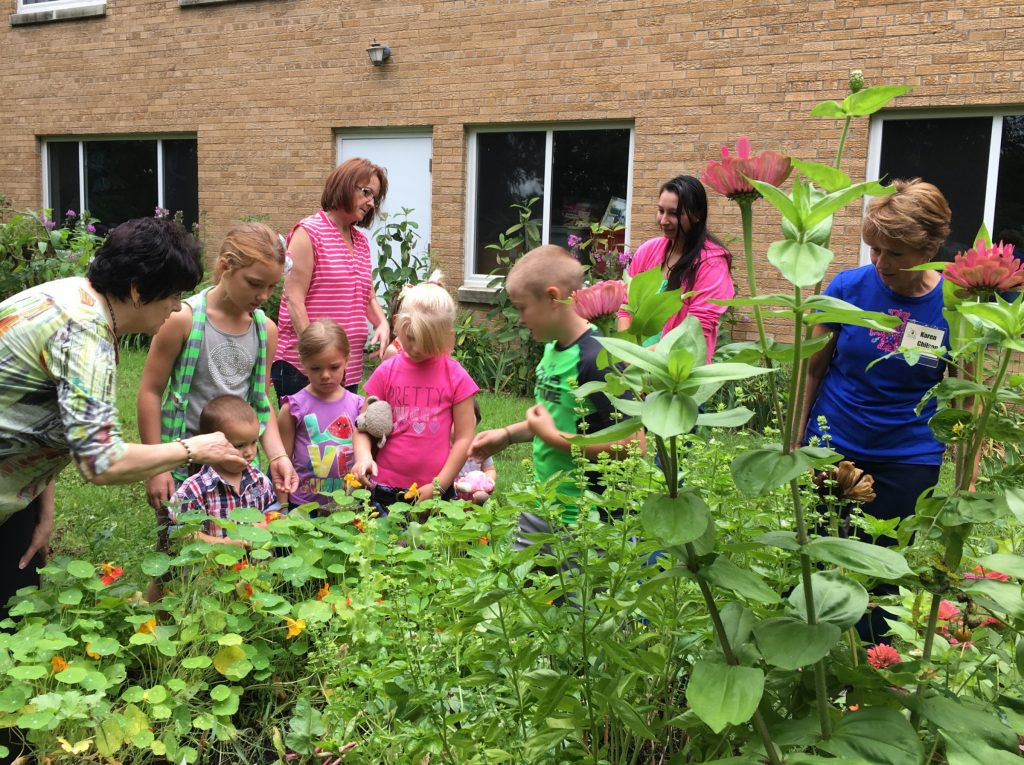 Master Gardener Volunteers engage families a the Family Enrichment Center.