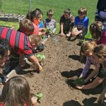 image of kids gardening