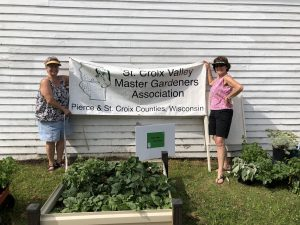 gardeners holding sign