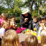 volunteering teaching kids how to garden