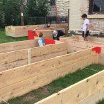 image of gardeners building raised beds