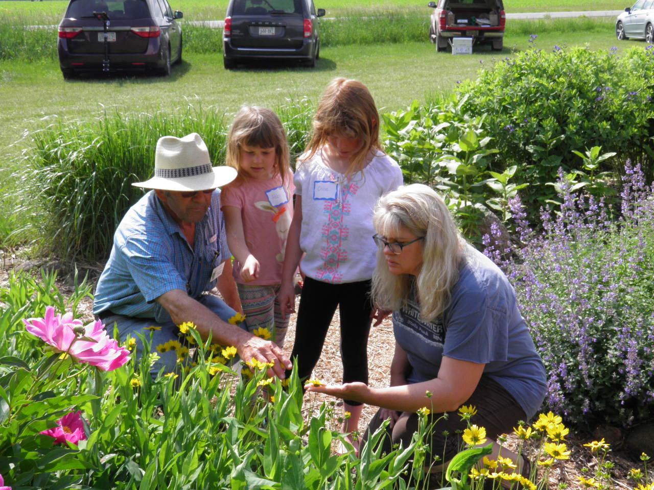 Kids exploring in the garden with Master Gardener Volunteers