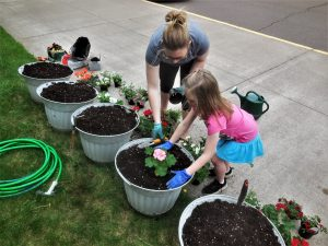 Woman and child planting flowers